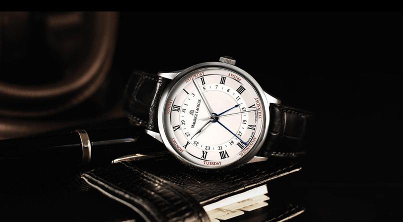 Reloj Cinq Aiguilles con correas negras y cartula en color plateado con detalles en blanco y negro