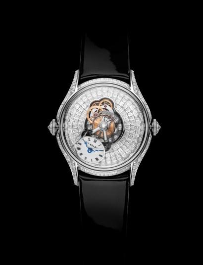 Reloj MB&F con correas negras y caratula con diamantes visto de frente