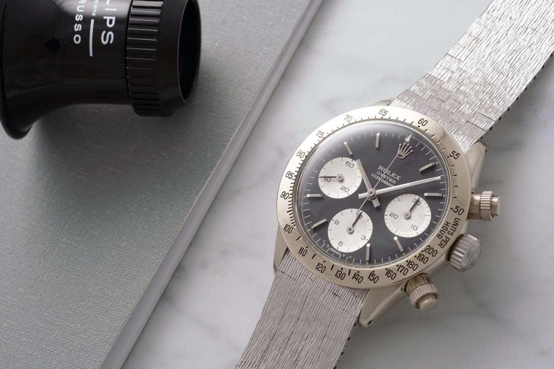 Rolex Daytona de oro blanco con el dial negro con tres esferas blancas