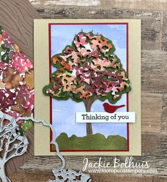 This handmade card was made as a masculine thinking of you card with tree and red bird.