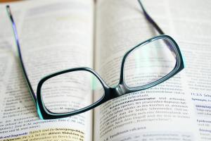 reading glasses on open book