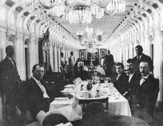 Men dining in the Main Cabin of the Crescent City