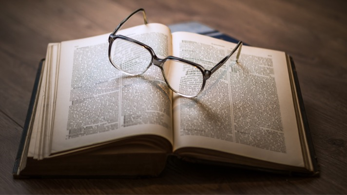 Book with reading glasses