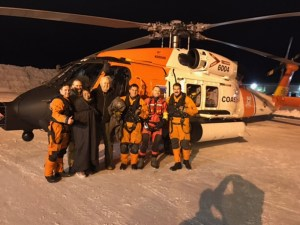 Three survivors aboard a downed Cessna 180 pose for a photo with the Coast Guard Air Station Kodiak MH-60T Jayhawk crew who rescued them near the Chakachatna River on the west side of Cook Inlet in the Kenai Peninsula Borough, Alaska, Jan. 30, 2017. The three survivors, pilot Josh Smith, his daughter Danielle Smith, and John White reported no injuries. U.S. Coast Guard photo.