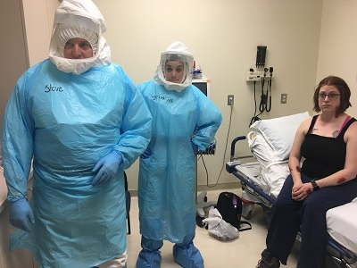(Left to right) Nurse Steve, Nurse Lydia, and patient / actor Patricia Roberts during a simulated examination. Kayla Desroches/KMXT