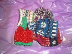 Five little woolly hats...