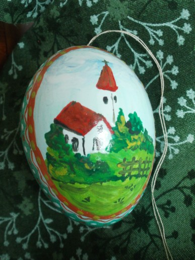 varnished egg with a historic motif