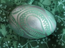 silver pen on green egg