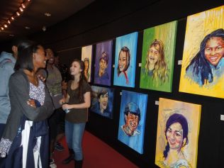 Sophomores Morgan Brewton-Johnson, Denzel Franklin, and Hannah Seabright admiring Donice's paintings