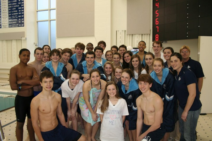 The swim team gets together for a photo on Senior Night. Photo: Leo Weiner