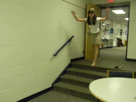 Junior Annie Armstrong takes a leap of faith that Ms. Smith won't catch her.