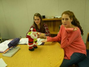 "Juniors Anna Hoffman and Sarah Thomson are annoyed with the ""Gangam Style"" singing Santa Clause. Photo: Julia Beck"