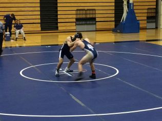 Michael Sloman (left) grabs his opponent's neck to try and take him down