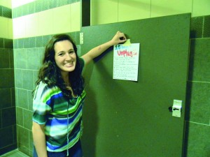 Senior and SAB member Arielle Levin hangs a sign to educate students on the importance of unplugging.