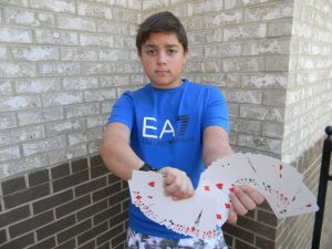 Freshman Jason Rosenbloum is quickly mastering close-up card tricks. Photo: Margaret Bethel