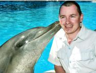 Ridiculously attractive dolphin and husband.
