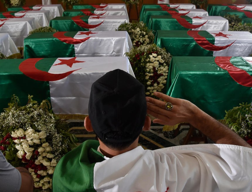 Algeria buries repatriated skulls of resistance fighters as it marks independence from France