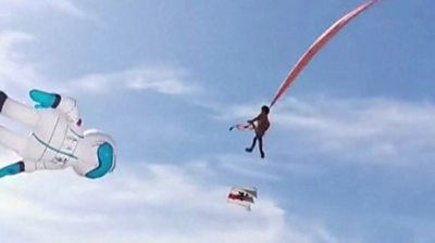 Girl thrown into air by kite in Taiwan