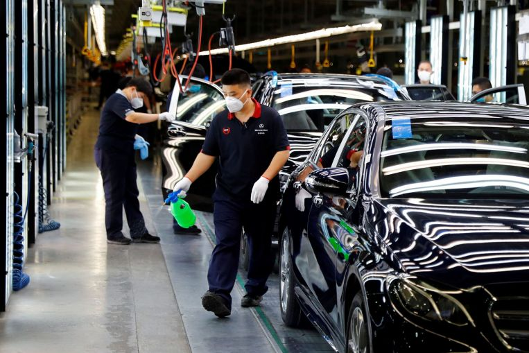 China factory activity up for 5th month, Japan snaps 4-month fall