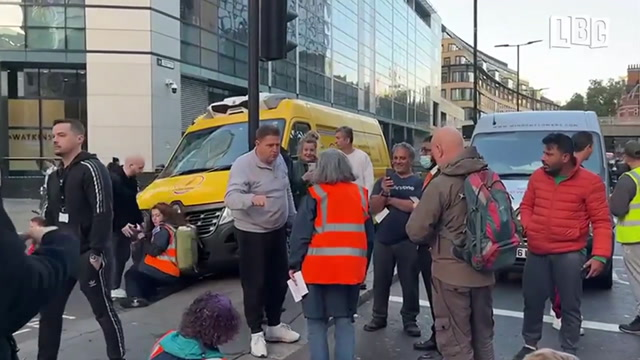 Police step in as van tries to ram Insulate Britain mob after they GLUE themselves to road