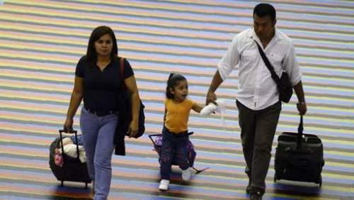 Passagiers op de internationale luchthaven van Caracas. © afp.