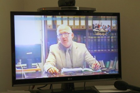 Prosecutor Samuel Finielz talks to journalists via a Skype video link from Guadeloupe on the Wendy Montulet murder case