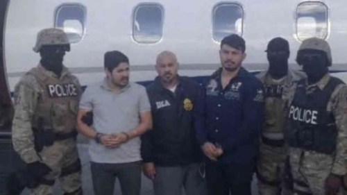 Mr Campo (in the grey shirt) and Mr Flores (in blue) were arrested last November and flown to New York