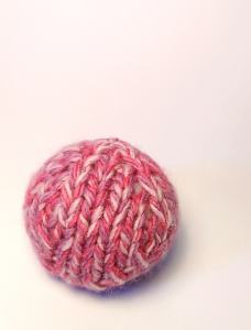 Pink knitted sphere