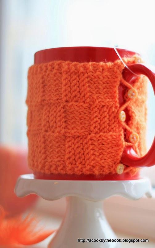 Knit a pretty mug cozy in basketweave stitch.
