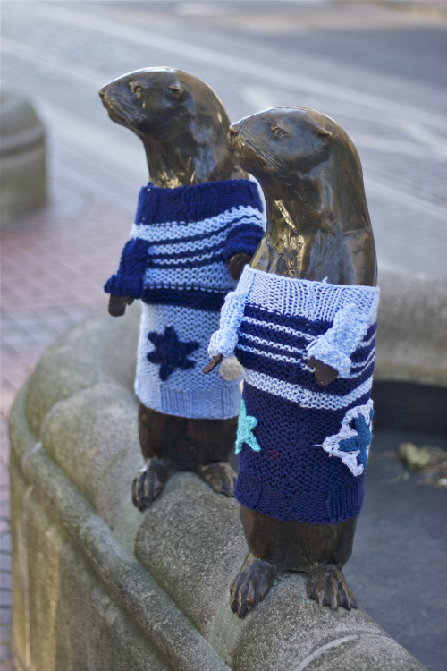 Yarnbombing puts rotating outfits on city statues.