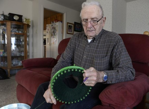Vet loom knits hats, to take part in ManCraft show in Colorado.