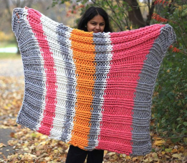 Knit a super bukly striped blanket in no time.