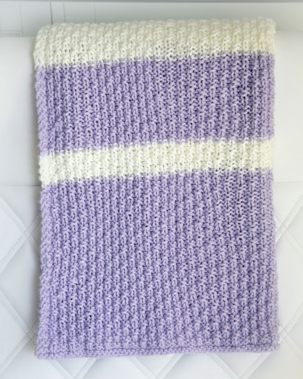 An easy textured and striped baby blanket to knit.