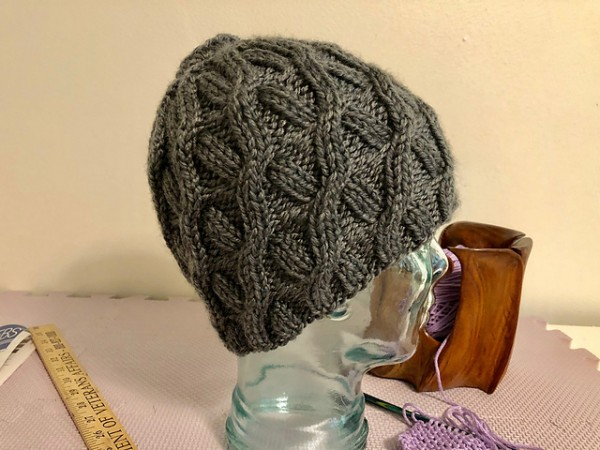 A Pretty Cabled Hat for Your Messy Bun