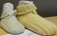 Knitted Victorian baby shoes by Sally Kentfield shown at the Knitting History Forum Conference in November 2014