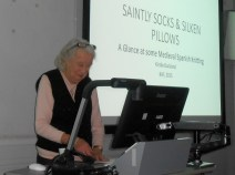 Kirstie Buckland presenting a paper at the Knitting History Forum Conference in November 2015