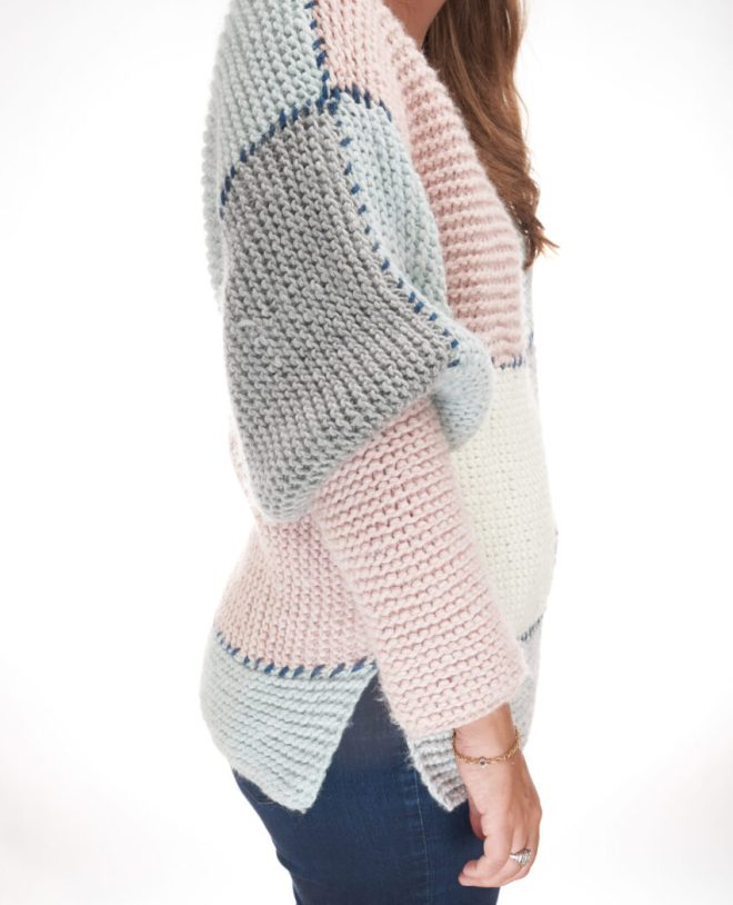 The block sweater has oversized sleeves cuffed at the elbow for a comfy original look.