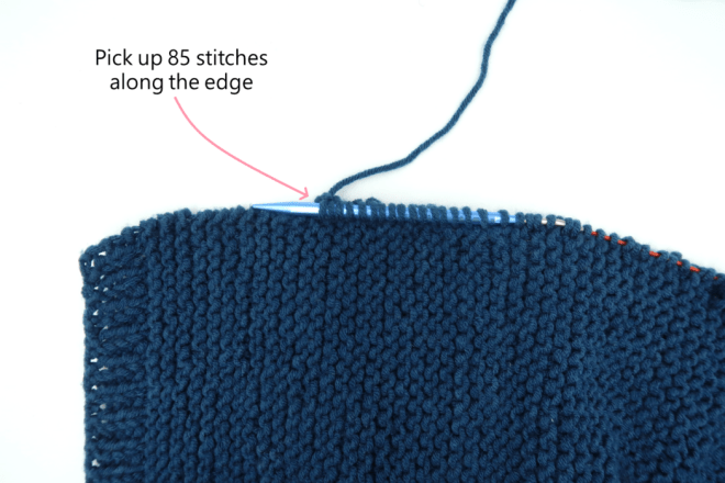 Pick up stitches on the edge to form the knitting buttonholes in ribbing of the short cardigan knitting pattern