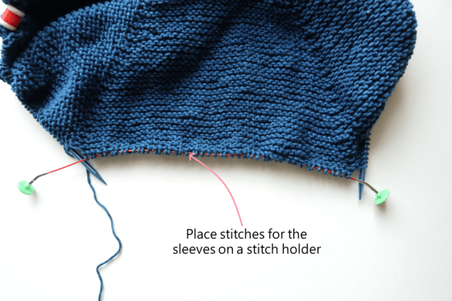 Place stitches on hold for the sleeves of the top down knit cardigan pattern