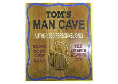 toms man cave sign