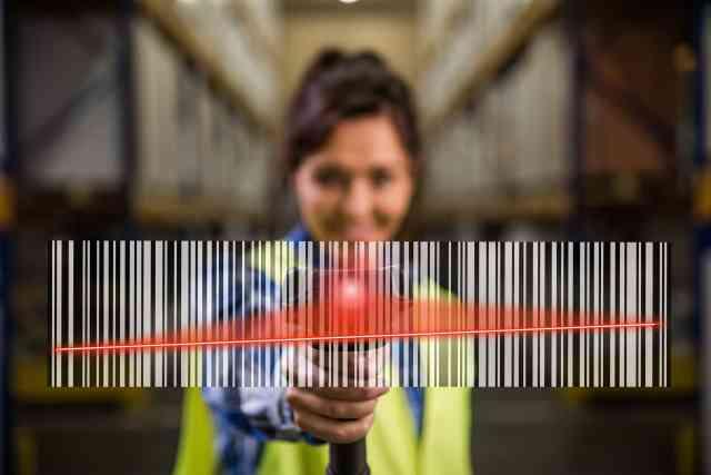 Woman in hi-vis jacket scanning a barcode