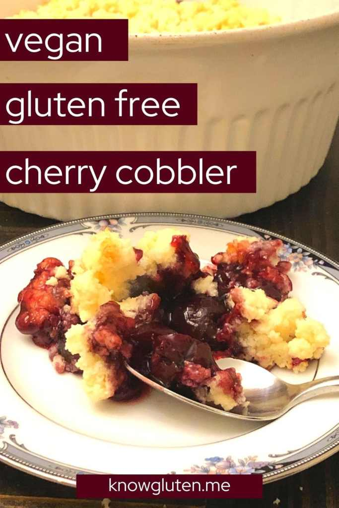 gluten free cherry cobbler on a plate with a spoon in front of a baking dish.