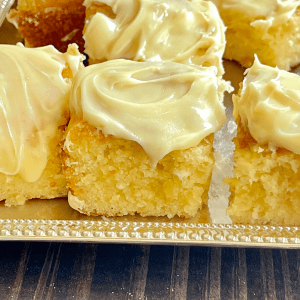 Pieces of lemon cake on a silver tray.