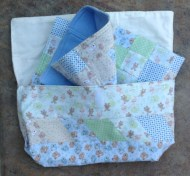 Patchwork bag holding my 'Around the World' buggy quilt