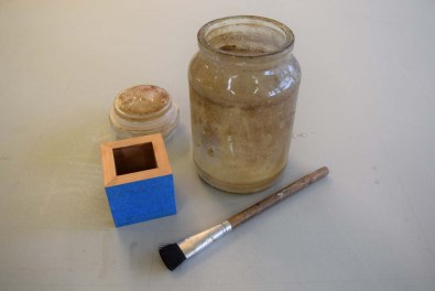 Remove glue on the inside with a slightly damp brush