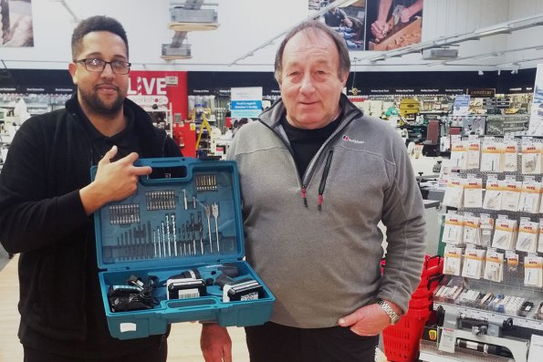 Alan Edwards being presented with a Makita drill kit