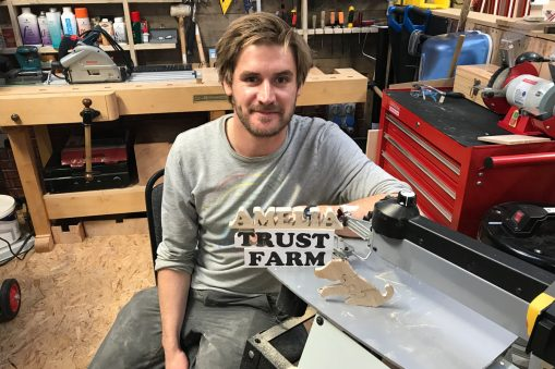 Paul attending product training after purchasing a scroll saw for use with the children on the farm