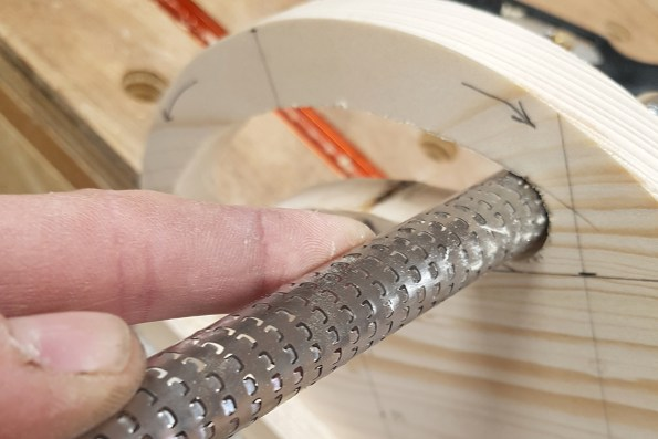 Smoothing the insider of the handle with a rasp