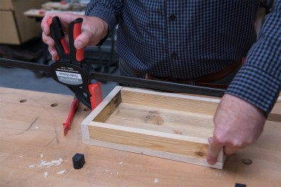 Place the frame on top of the tray panel and clamp in place