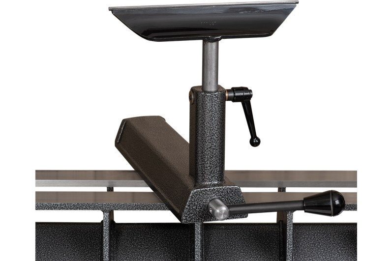 The tool rest slides along stainless steel bedways